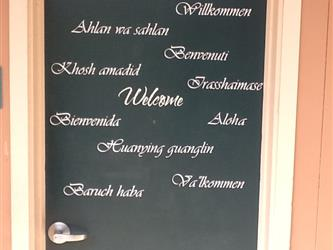 door with welcome printed in many languages