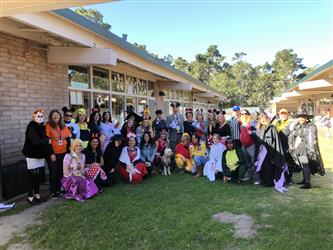 Staff wearing Disney-themed costumes from Halloween 2019